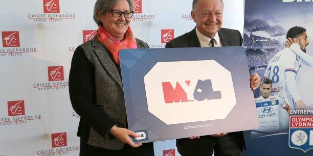 Stéphanie Paix, directrice de la Caisse d'Epargne Rhône-Alpes et Jean-Michel Aulas, président de l'OL