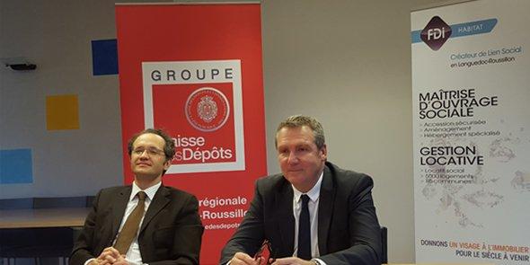 Olivier Camau (Caisse des dépôts LR) et Dominique Guérin (FDI Habitat) signent une convention partenariale le 4 janvier 2016 à Montpellier.