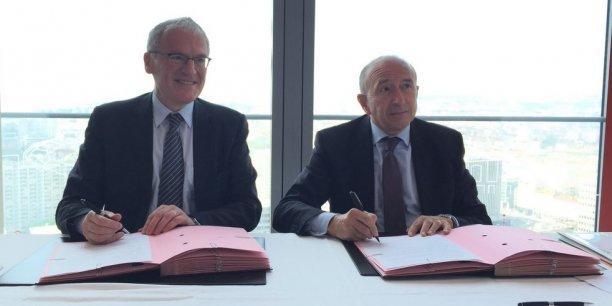 Jean-Bernard Levy (à gauche) patron d'EDF, et Gérard Collomb (à droite), président de la métropole de Lyon.