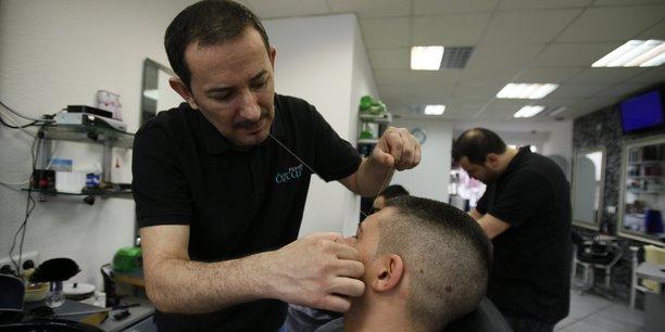 Un coiffeur turc dans le quartier de Little Istanbul à Cologne en 2013.