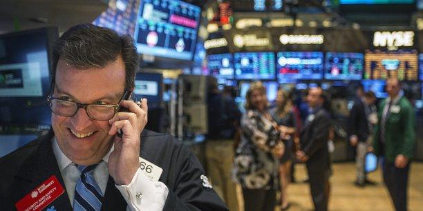 Un trader travaille dans la salle principale du New York Stock Exchange, le 31 juillet 2016.