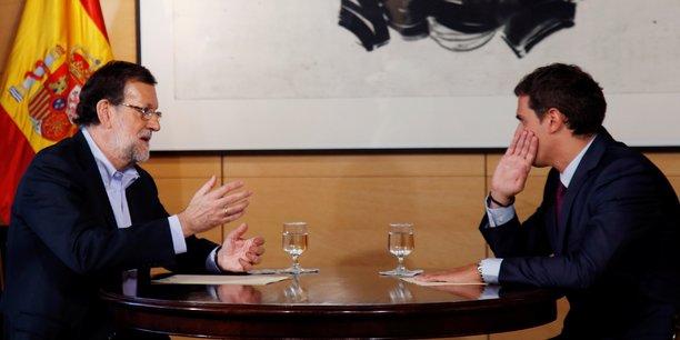 Mariano Rajoy et Albert Rivera (à droite) ont discuté pendant plus d'une heure au Parlement espagnol, jeudi 18 août.