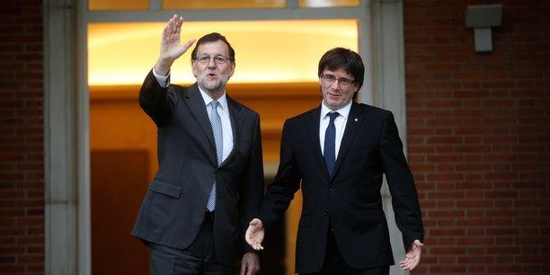 Mariano Rajoy va-t-il définitivement dire au revoir à Carles Puigdemont (à droite) et à la Catalogne en septembre 2017 ?