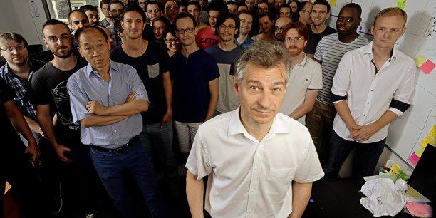 Jean-Jacques Bérard, vice-président R&D d'Esker, entouré de ses équipes.
