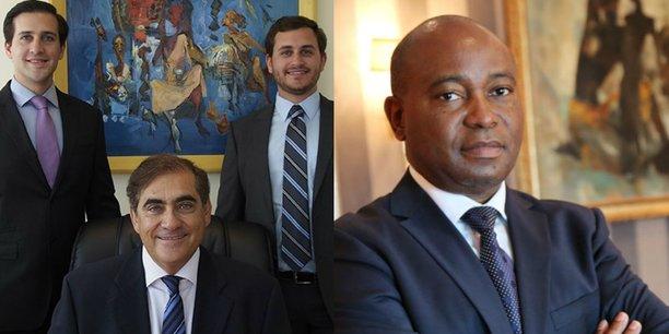 L'homme d'affaires américain Elwyn Blattner, président du groupe éponyme basé à Kinshasa, entouré de ses deux fils (à gauche) et Deogratias Mutombo, gouverneur de la Banque centrale de Congo (à droite).
