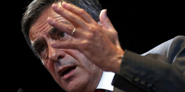 Dès juin 2014, François Fillon candidat à la primaire UMP (le parti est rebaptisé Les Républicains en mai 2015) présente un programme choc et très libéral pour redresser l'économie française. (Photo: A Menton, le 14 novembre 2014, l'ex-premier ministre lors de son discours sur l'immigration maîtrisée.)