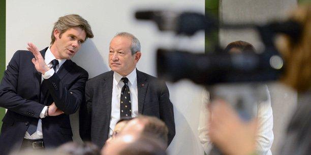 Michael Peters et Naguib Sawiris.