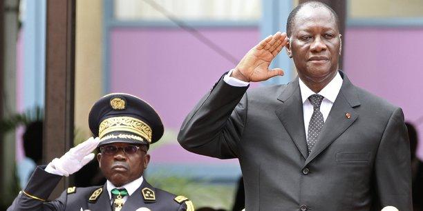 Alassane Ouattara, ici avec l'ancien chef des armées, Bakayoko.