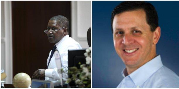 Aliko Dangote, à gauche, et Eli Ben-Shoshan, le patron de DuPont Clean Technologies, à droite.