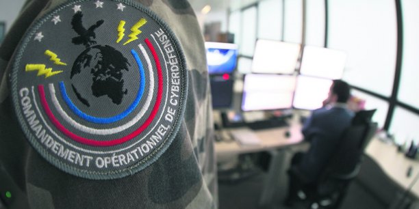 French soldiers work at the French army cyber defence operational command center headquarters, in Paris