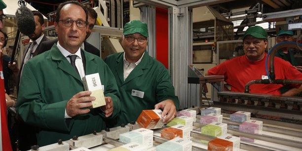 L'ancien président de la République François Hollande en visite chez Scop-Ti en 2015.