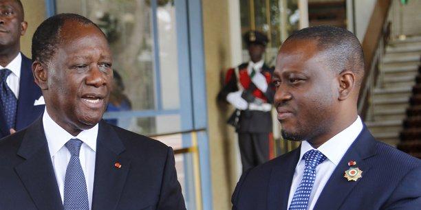Guillaume Soro, président de l'Assemblée nationale de Côte d'Ivoire en discussion avec le Président Alassane Ouattara, au palais présidentiel à Abidjan le 24 octobre 2014.