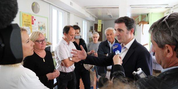 Eric Piolle en visite auprès des Restos du Coeur de Grenoble.