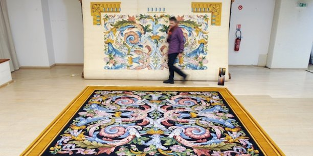 Louis XIV, tapis de style classique, réalisé en 1970 par les liciers de la manufacture d'après un modèle du peintre Charles Lebrun.