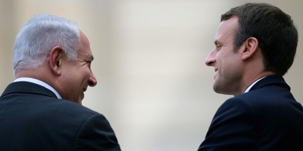 French president emmanuel macron escorts israeli prime minister benjamin netanyahu after their meeting at the elysee palace in paris[reuters.com]
