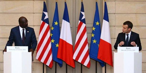 Les présidents George Weah et Emmanuel Macron lors la conférence de presse conjointe, le 21 février 2018, au Palais de L'Elysée à Paris.