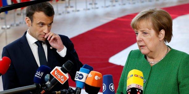 Première contributrice nette au budget européen, l'Allemagne s'est dite prête à payer davantage pour le futur budget 2021-2027. La France et l'Italie, qui suivent l'Allemagne dans la liste des plus grands contributeurs nets, sont pour une augmentation, assortie de conditions. (Photo : Emmanuel Macron et Angela Merkel, le vendredi 23 février lors du sommet informel des Vingt-Sept à Bruxelles)