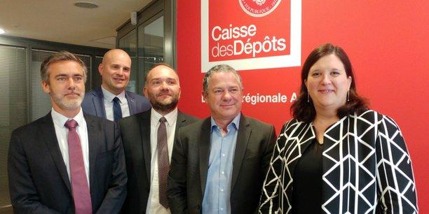 De gauche à droite : Jean-Baptiste Desanlis (CDC habitat), Rémi Heurlin (CDC Bordeaux), Jérôme Genin (CDC biodiversité), Pascal Morganti (Transdev) et Annabelle Viollet (directrice régionale adjointe CDC Nouvelle-Aquitaine).