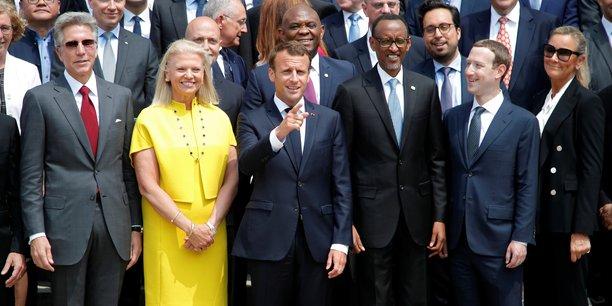 Le président de la République, Emmanuel Macron, entouré de Ginni Rometty, Pdg de IBM (à gauche) et du président Rwandais Paul Kagame et du Pdg de Facebook, Mark Zuckerberg (à droite) - Elysée, Paris, le 23 mai 2018, Sommet Tech for good.