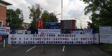 Près de la banderole déployée ce matin par l'intersyndicale de FAI  on reconnait le logo triangulaire sur fond rouge du puissant syndicat IG Metal.
