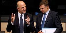 L'Italie dispose maintenant de trois semaines pour présenter un budget révisé. Ici, Pierre Moscovici, le commissaire européen aux Affaires économique au côté de Valdis Dombrovskis, vice-président de l'exécutif européen.
