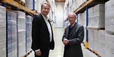 Eric Sarrat, à droite, au côté de Bernard Legoueix, directeur commercial de la Biscuiterie Poult, à Montauban, autre grand client de GT Logistics.