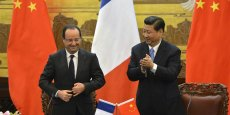 François Hollande et son homologue chinois Xi Jinping, à Pekin. Copyright Reuters