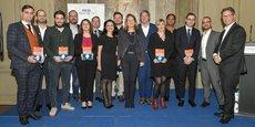 Les lauréats du palmarès accompagnés de leurs parrains et d'une partie de l'équipe de La Tribune.