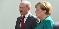 Olaf Scholz, ministre des Finances allemand avec la chancelière Angela Merkel.