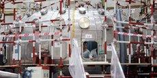 Des hommes travaillent sur le réacteur Tokamak HL-2M, dans la province du Sichuan (Chine), le 5 juin 2019.