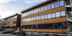 Dotée d'une ossature et d'un bardage en bois, le bâtiment Wood Office dispose également d'une toiture photovoltaïque.