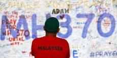Les autorités malaisiennes soulignent que les antécédents de toutes les personnes à bord, soit 239, sont passés au peigne fin: pilotes, équipage, passagers, et même les mécaniciens au sol ayant travaillé sur l'avion avant son décollage. (Reuters/Damir Sagolj)
