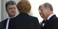 La discrétion (était) une condition du succès de cette rencontre entre Vladimir Poutine et Petro Porochenko, a précisé l'Elysée. (Photo : Reuters)
