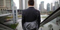 Les employés de bureau et les cadres chinois font souvent plus de huit heures supplémentaires par jour, en dépit du droit du travail. | REUTERS