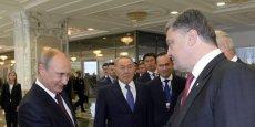 Vladirmir Poutine et le président ukrainien Petro Porochenchenko, lors de leur 2e rencontre, le 27 août Minsk.