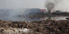 Les opérations de Veolia à Tianjin n'ont pas été affectées par les explosions intervenus dans la ville mercredi, a assuré l'entreprise. (Photo: le 16 août 2015, des dépressions de terrain remplies de liquide de composition très incertaine sur le site de l'explosion de Tianjin, Chine)