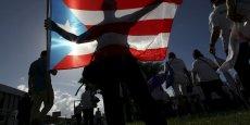 Rico, qui compte 3,5 millions d'habitants, a cumulé une dette de quelque 72 milliards de dollars après plusieurs années de récession. Sur la photo, une manifestation à Porto Rico le 5 novembre pour améliorer la protection sociale.