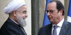 A la faveur de la levée des sanctions internationales, l'Iran s'ouvre aux entreprises occidentales Paris compte bien y prendre sa part dans un maximum de secteurs d'activités. Sur la photo, le président iranien avec son homologue français dans la Cour de l'Elysée, le 28 janvier.