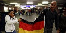 Deux migrants arrivant à Berlin le 11 septembre 2015.