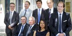 L'équipe de Champeil Asset Management, avec Jean-Louis Champeil, assis au centre, et son fils Axel debout au premier plan .