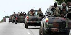 Un convoi de soldats des Forces républicains (à l'époque pro-Ouattara), le 29 avril 2011 à Abidjan, la capitale ivoirienne.