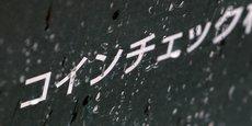 L'enseigne de la plate-forme japonaise Coincheck. Un groupe de dix traders en cryptomonnaies assignera en justice jeudi la plate-forme pour le vol le mois dernier de 530 millions de dollars d'argent virtuel.