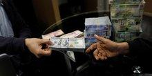 dollar dinar change Libye