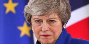 Theresa may s'explique aux communes apres le report du brexit