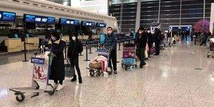 coronavirus, avion-cargo, passagers, rapatriement, ressortissants américains, aéroport, Wuhan, Chine,