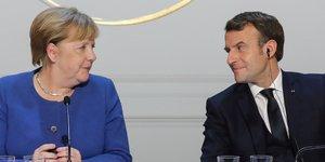 Angela Merkel et Emmanuel Macron donnent une conférence de presse après une réunion à l'Élysée, le 9 décembre 2019 à Paris