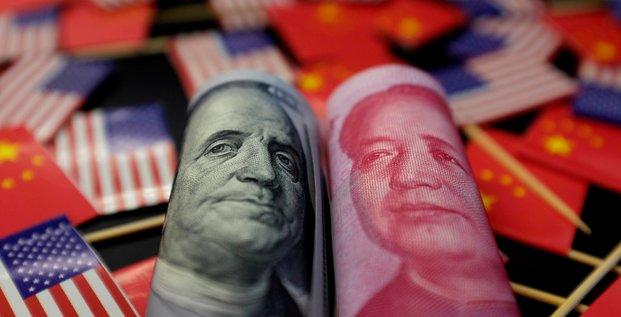 La chine laisse le yuan enfoncer le seuil de 7 pour un dollar