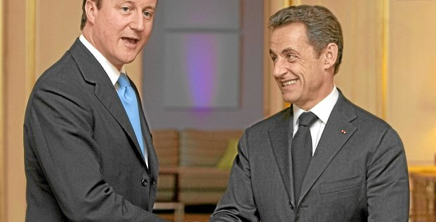 French President Nicolas Sarkozy (R) meets with Leader of the British Opposition Conservative Party David Cameron in London, on March 12, 2010. Sarkozy criticised the United States on Friday over bidding rules for a tanker jet contract, saying it was not the way for Washington to treat its European