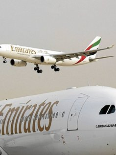 Two Emirates aircraft seen at Dubai airport on the first day of of the 8th Aerospace Expo in Dubai,  Sunday, December 7, 2003. General Electric Co. and United Technologies Corp.'s Pratt & Whitney won a $1.5 billion contract to supply Emirates airline with engines for Airbus SAS A380 aircraft,<br /><