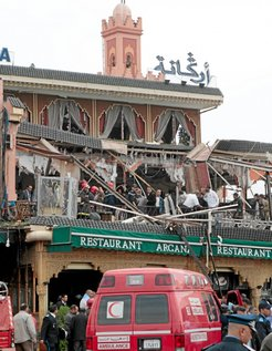 An ambulance is seen at the scene of an explosion that rocked the Argana cafe in Marrakesh's main Jamaa el-Fnaa square April 28, 2011. An explosion killed 14 people, including foreigners, on Thursday in a busy cafe in the Moroccan tourist destination of Marrakesh, and authorities said the initial si